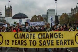 Protest banner: Climate change, 12 years to save earth.